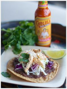 Recipe for Baja Chicken Tostadas. Half the reason I pinned this is because there's a Cholula bottle in the background :) Indian Chicken Recipes, Mexican Food Recipes, Dinner Recipes, Healthy Recipes, Mexican Dishes, Dinner Ideas, Chicken Tostadas, Cooking Photos, Cooking Tips
