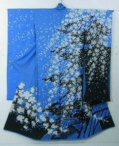 This is a vibrant blue color Kimono silk fabric cut into Furisode shape and stitched roughly before sewing to make Furisode