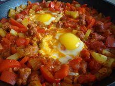 shakshouka tunisian food........my husband makes this, its DELICIOUS