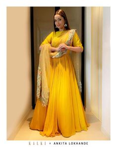With summers just around the corner, take a cue from Ankita Lokhande summer ethnic style and dress in this statement Kalkifashion yellow anarkali! The spirited number gives out the aesthetic of a shiny goddess with the flare and silhouette. Party Wear Indian Dresses, Indian Gowns Dresses, Dress Indian Style, Indian Wedding Outfits, Indian Outfits, Wedding Dress, Bridal Outfits, Boho Wedding, Kurti Designs Party Wear