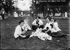 Photograph shows girls from the Washington Irving High Schools, New York City, having a picnic at the Midsummer Day Festival which was held at Pelham Bay Park in the Bronx on June 23, 1911.