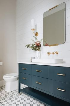 teal vanity + square mirror + brass accents + freestanding vanity + bathroom vanities + surface mount sink + wall sconce + white shiplap + blue and white tile Blue Bathroom Vanity, White Bathroom Tiles, White Shiplap Wall, Teal Bathroom, Small Bathroom Decor, Bathroom Tile Designs, Bathroom Decor, Shiplap Bathroom, White Shiplap