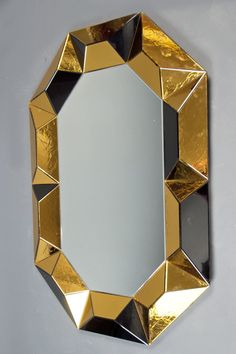 KAGADATO selection. The best in the world. Industrial mirror design. **************************************Robert Rida, Octagonal Multifaceted Mirror, 1990.