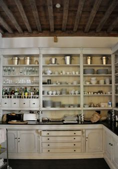 Love how the open shelves are framed so they look like a hutch of some sort. Décor de Provence: Out With The New