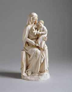 """Seated Virgin and Child, """"Rattier Virgin,"""" ivory, 201 x 92 x 73 mm. London, Victoria and Albert Museum, 200.1867"""