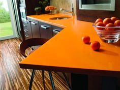 Your kitchen countertops should not only reflect your style but also accommodate your meal preparation needs. Learn the pros and cons of popular kitchen countertop materials. Engineered Stone Countertops, Cost Of Countertops, Silestone Countertops, Dark Brown Kitchen Cabinets, Brown Kitchens, Kitchen Cabinet Styles, Glass Kitchen, New Kitchen, Kitchen Ideas