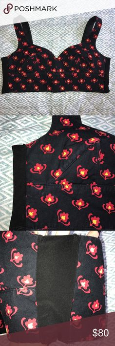 Miu Miu Floral Crop Top Size small-medium. No size tags. Banded sides allow it to stretch. Adjustable back as well. Black is slightly faded. Beautiful red and yellow floral design. Miu Miu Tops Crop Tops