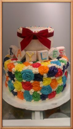 A birthday cake i just finished, the inside is rainbow colored layers also!