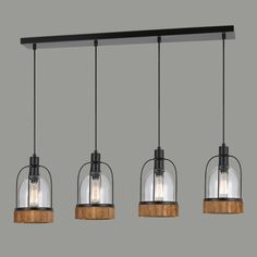 Featuring four bell jar-shaped lights with factory-inspired black metal fixtures and cage-like accents, this unique hanging pendant adds modern industrial styling to your decor. Its rustic wood bases, glass shades and exposed bulbs light up a room with an open, natural warmth.