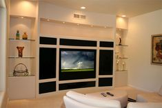 Custom Drywall with gloss handless doors giving a smooth uncluttered apperance