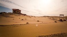 Timelapse of an abandoned ghost town train station during a sandstorm while the sand is shifting in a landscape setting with dense scattered clouds in Southern Namibia Travel And Tourism, Ghost Towns, Train Station, Stock Footage, Monument Valley, Abandoned, Southern, Country Roads, African