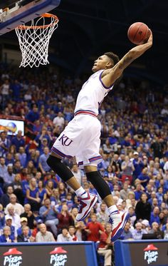 Kansas guard Kelly Oubre pulls back on a breakaway dunk against Washburn during the second half on Monday, Nov. 3, 2014 at Allen Fieldhouse. #KU