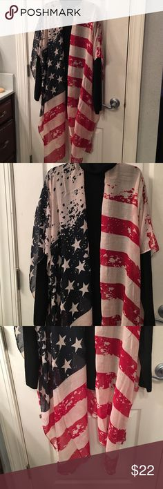 "Cape Flag Colors Cape that just throw over with red,white and blue.  Great for the 4th of July.  Never been worn.  Approximately 39"" wide and from neck down back 32"".  One size Jackets & Coats Capes"