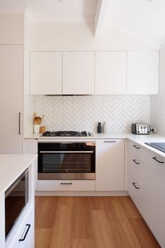 Kitchen renovation by Red Lily Renovations, Perth. Featuring bohemian pendant light, white cabinetry and herringbone tiles. Dyi Kitchen Ideas, Home Decor Kitchen, Kitchen Interior, Home Kitchens, Kitchen Design, Kitchen Splashback Tiles, White Gloss Kitchen, Kitchen Remodel, Kitchen Reno