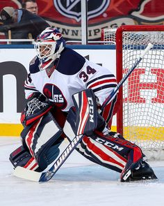 Goaltender Michael Hutchinson of the Winnipeg Jets takes part in the pregame warm up prior to NHL action against the Edmonton Oilers in the 2016 Tim...