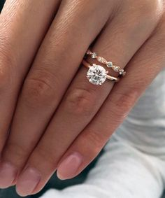 Rose gold solitaire engagement ring. I am totally in love with this wedding band. http://www.ringsforwomen.org/rings/14k-gold-round-cut-solitaire-engagement-ring-review/