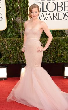 AMY ADAMS  The actress was positively elegant in a ballet pink Marchesa gown with a fitted bodice and tulle skirt. Retro-inspired finger waves and a heavy dose of diamond jewelry by Tiffany & Co. completed her demure look.