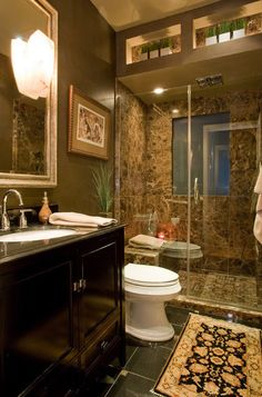 Fully open shower, Floor to ceiling, inviting lighting in shower and bathroom.  Inviting browns.