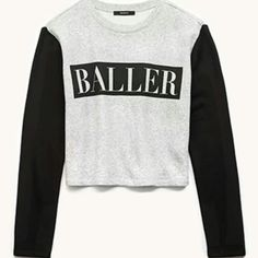 "Crop sweater ""Baller"" Crop sweater about belly button length. Never worn. Forever 21 Tops Crop Tops"