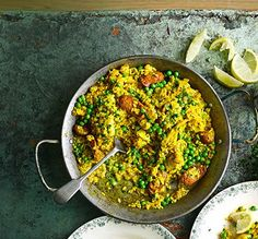 Try swapping traditional seafood paella for a chicken and chorizo version -  a hearty family supper for four