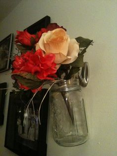 Mason Jars hung on the wall with wire and 3M hooks. Contents can be changed out for the seasons.