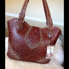 NWTMontana West Tooled Brown Tote Intricate tooled design and Silver studs. Faux leather. Gorgeous rich brown. Tag MSRP $120.99  Montana West Bags Totes