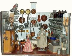 Kichen with open stove, and two wooden Peg Dolls.1850.