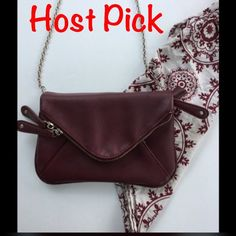 "⭐️HP 2/3⭐️Street Level Clutch Color is deep maroon/dark red. Light signs of wear on magnet clasp and light marks on clutch (pictured) chain does have slight tarnishing to silver color. Measures 9""x6"".  Can be used as a clutch or as a purse, a lot of storage for a smaller purse. Chain is detachable.⭐️Make an offer using the offer button or take advantage of my bundle discount! Trades PP Bags Clutches & Wristlets"