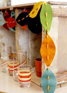 East Coast Creative: 10 Fall Kids' Crafts - Love the felt leave garland and twig art.