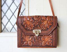 Vintage Tooled Leather Purse from WonsaponatimeVintage on Etsy, $68.00.