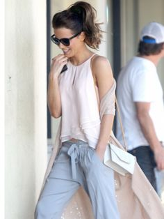 Kate Beckinsale exudes effortless femininity in silk top and tie-waist trousers. via @WhoWhatWear