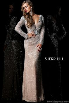 Free shipping on Sherri Hill 11004 nude long sleeve prom dresses available now at RissyRoos.com.
