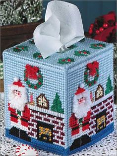 A whimsical Santa and pretty stained-glass designs adorn these boutique-style tissue toppers. They're quick to stitch on canvas with worsted weight and plastic canvas yarns. Two patterns included. Plastic Canvas Ornaments, Plastic Canvas Tissue Boxes, Plastic Canvas Crafts, Plastic Canvas Patterns, Plastic Mesh, Plastic Canvas Christmas, Box Patterns, Needlepoint Patterns, Canvas Designs