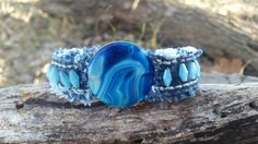 Check out this item in my Etsy shop https://www.etsy.com/listing/488971984/denim-cuff-with-blue-striped-agate-and