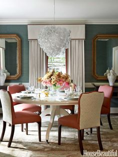 To freshen the dining room of a 1940s Charlotte, North Carolina, house, designer Lindsey Coral Harper hung a Glass Bubble chandelier from Homenature over a custom lacquered table, covered walls in green grass cloth from Sonia's Place, and backed Hickory Chair's Cabriole side chairs in Petite Fleur by Michæl Devine.   - HouseBeautiful.com