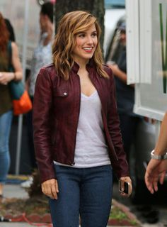 burgundy moto jacket, v neck tee, and jeans