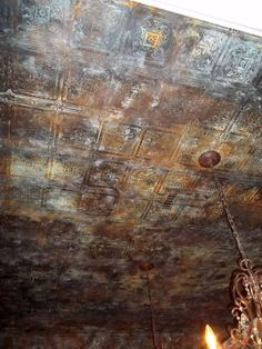 Aged tin ceiling - wallpaper & metal paint.