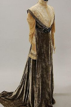 A mushroom velvet and lace gown, circa 1910, bearing a Jeanne Hallée label, with beaded medallion to the waist front, lace bodice and sleeves. Front