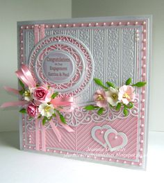 Engagement Card - this time using dies from Creative Expressions / Sue Wilson, Grace, Canadian Border and Floral Stripes Embossing Folder. Also using Nellie Snellen Hearts and a cute little leaf from the Spellbinders Botanical Swirls and Accents Set. Flowers from Wild Orchid Crafts, White Gold Centura Pearl from Crafters Companion, Pink & Green Card from Papermilldirect.