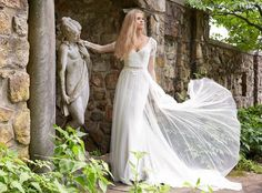 pretty wedding dress with deep v neck and long, sheer sleeves @myweddingdotcom
