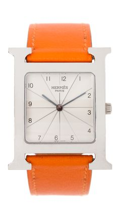 "This is an authentic HERMES Calfskin H Hour PM Watch in Orange. This stylish watch is crafted of luxurious calfskin leather. The watch features a silver Hermes ""H"" casing and a white face and has Swiss made/quartz mechanism. This is a marvelous watch, ideal for a one of a kind style, from Hermes! Size: Length: 7"" Height: 1"" Heure H Hermes steel watch, 30.5 x 30.5mm, white dial, quartz movement, smooth orange calfskin leather strap  The condition of this watch is great, very minimal use and…"