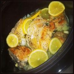 Slow Cooker Lemon and Thyme Chicken Recipe Main Dishes with olive oil, chicken, pepper, salt, lemon, onions, dried thyme, dry white wine, crushed garlic