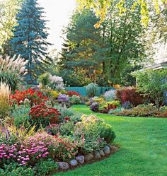 Curving beds - Undulating beds of low-maintenance perennials give a finished look to your landscape and decrease yard chores. Wide green paths curve through this yard in Brown Deer, Wisconsin, a suburb of Milwaukee.
