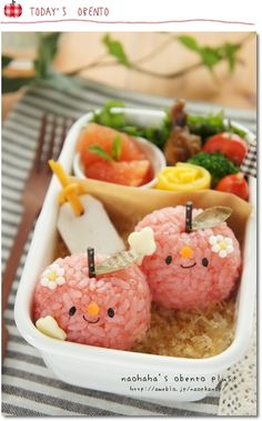 I saw this and couldn't resist posting it. It's apples with little apple blossoms on them! Which is cute! And unless there is a type of red rice they dyed the rice. This is playing with your food also known as bento boxes. :D