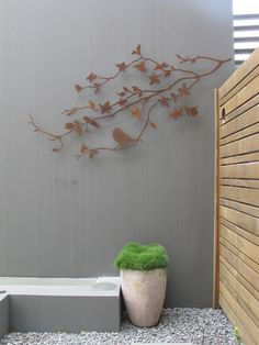 While we're talking about maximizing design ideas for tight spaces, check out this metal wall art deco. It only sits out from the wall slightly but it adds to much interest to small patios, courtyards and balconies. 'Summer Branch' design. This installation was by Brannelly Outdoors in QLD. Made in Melbourne by Entanglements metal art