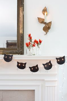 Decorate your mantel with a cat garland that is just purr-fect.