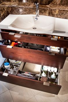 The same rules apply for the bathroom as for the kitchen. Keep your counters clear of stuff. Use a vanity with drawers. Don't even consider a pedestal sink or a vanity with doors if you tend to be a hoarder. Get the most convenient, easy-to-use storage with drawers. (The drawers can even be organized.)