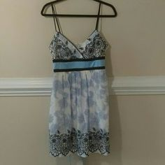 I just added this to my closet on Poshmark: Teeze me sundress white and blue with embroidery. Price: $10 Size: 10