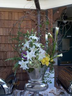 Willow Branch Caged Design with White Lilies, Callas and Yellow Roses  http://www.busseysflorist.com/wedding-flowers/