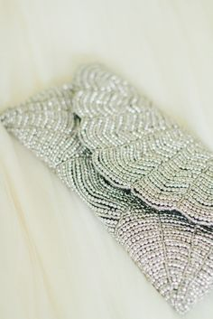 This fabulous silver beaded clutch is anything but ordinary. Take it out on the town and you'll be sure to have all of your beauty necessities on hand. | Mary Kay